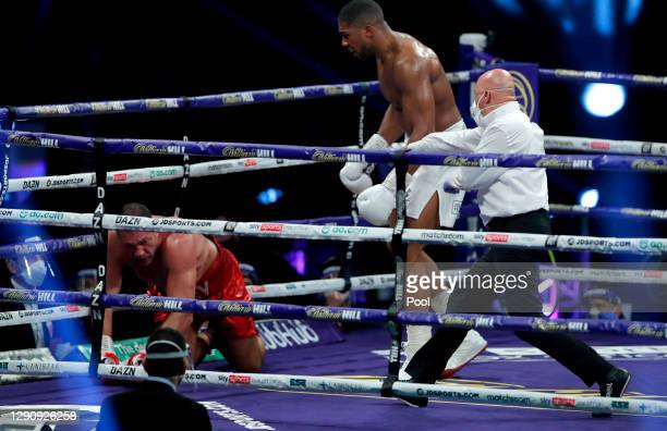The referee stops the fight as Anthony Joshua knocks down Kubrat Pulev during the IBF, WBA, WBO and IBO World Heayweight Title fight between Anthony...