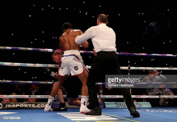 The referee stops the fight as Anthony Joshua punches Alexander Povetkin during the IBF WBA Super WBO IBO World Heavyweight Championship title fight...
