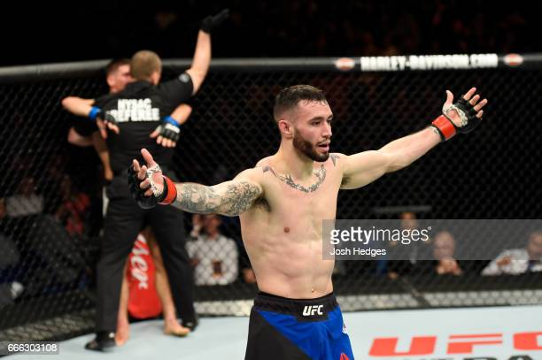 The referee stops the fight as Shane Burgos celebrates his technical knockout victory over Charles Rosa in their featherweight bout during the UFC...