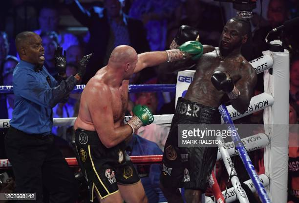 The referee stops the fight when the towel is thrown in by Wilder's trainer as British boxer Tyson Fury defeats US boxer Deontay Wilder in the...
