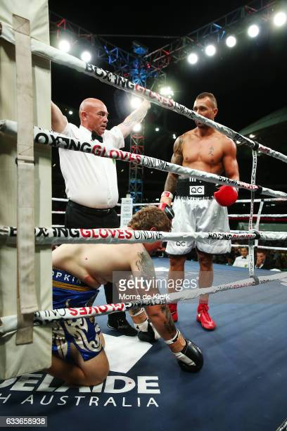 The referee stops the heavyweight bout between Quade Cooper and Jack McInnes at Adelaide Oval on February 3 2017 in Adelaide Australia