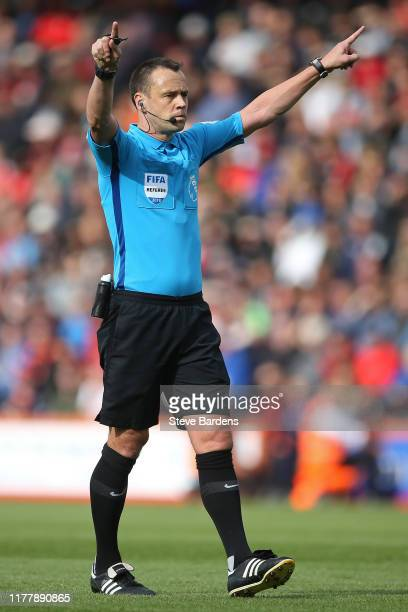 The Referee Stuart Attwell confirms a VAR decision during the Premier League match between AFC Bournemouth and West Ham United at Vitality Stadium on...