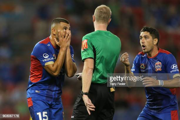 The referee talks to Andrew Nabbout and Dimitri Petratos of the Jets during the round 15 ALeague match between the Newcastle Jets and the Central...
