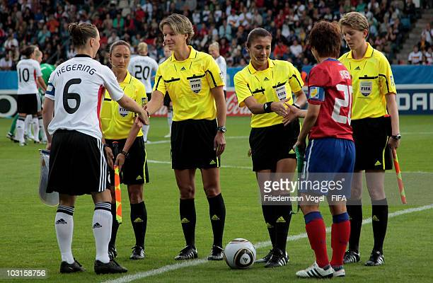 The Referee team Sarah Ho Alexandra Ihringova Silvia Reyes and Allyson Flynn with Marina Hegering of Germany and Kim Hye Ri of Korea during the FIFA...