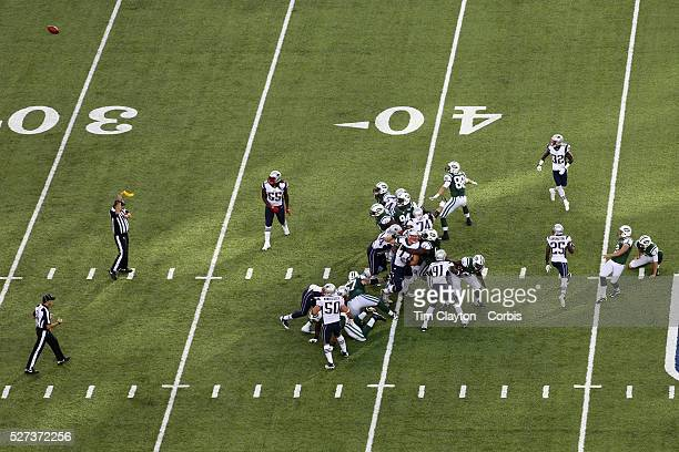 The referee throws his penalty flag as New York Jets place kicker Nick Folk misses on a 56 yard overtime field goal attempt which resulted in a 15...