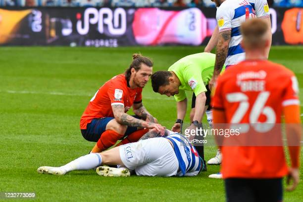 The referee Tony Harrington check up on Lyndon Dykes of QPR during the Sky Bet Championship match between Queens Park Rangers and Luton Town at...