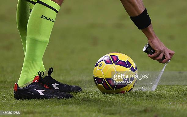 The referee uses his vanishing spray during the 2014 Italian Super Cup match between Juventus FC v SSC Napoli at the Jassim Bin Hamad Stadium on...