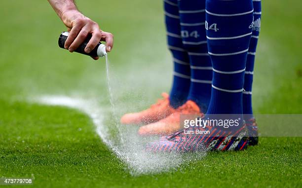 The referee uses vanashing spray for a free kick during the Bundesliga match between FC Schalke 04 and SC Paderborn at Veltins Arena on May 16, 2015...