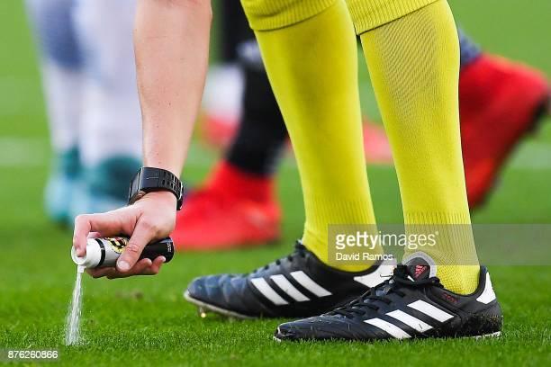 The referee uses vanishing spray during the La Liga match between Espanyol and Valencia at Cornella - El Prat stadium on November 19, 2017 in...