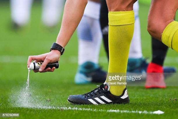 The referee uses vanishing spray during the La Liga match between Espanyol and Valencia at Cornella El Prat stadium on November 19 2017 in Barcelona...