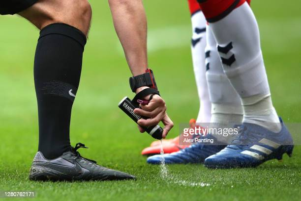 The referee uses vanishing spray during the Sky Bet Championship match between Middlesbrough and Reading at Riverside Stadium on October 17 2020 in...