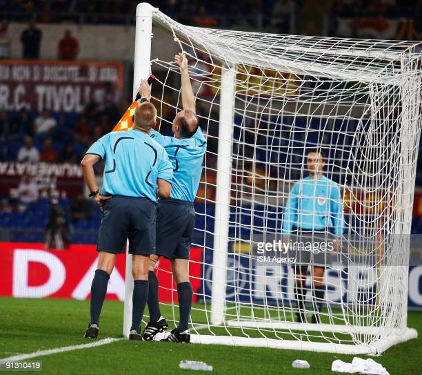 The referee Vladimir Hrinak and other officials try to fix the goal net during the UEFA Europa League Group E match between AS Roma and PFC CSKA...