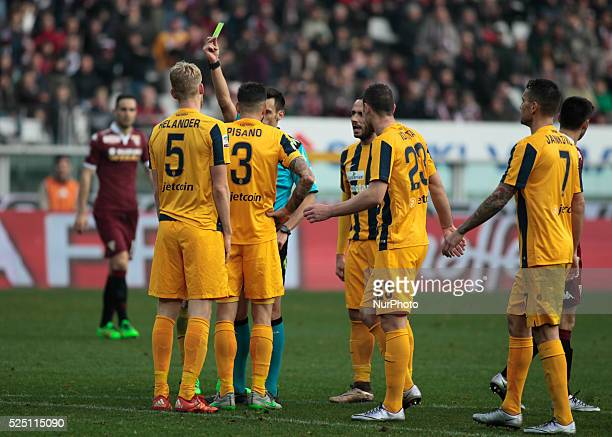 The referee warns Eros Pisano during the Seria A match between Torino FC and Hellas Verona FC at the Olympic stadium of Turin on january 31 2015 in...