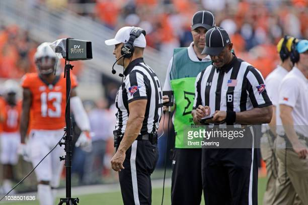 The referee watches a reviewed call during the game between the Boise State Broncos and Oklahoma State Cowboys at Boone Pickens Stadium on September...