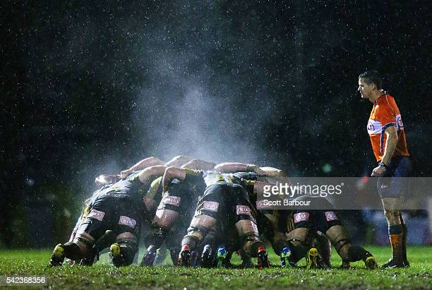 The referee watches as steam rises from a scrum during the Super Rugby Exhibition match between the Rebels and the Hurricanes at Harlequins Rugby...