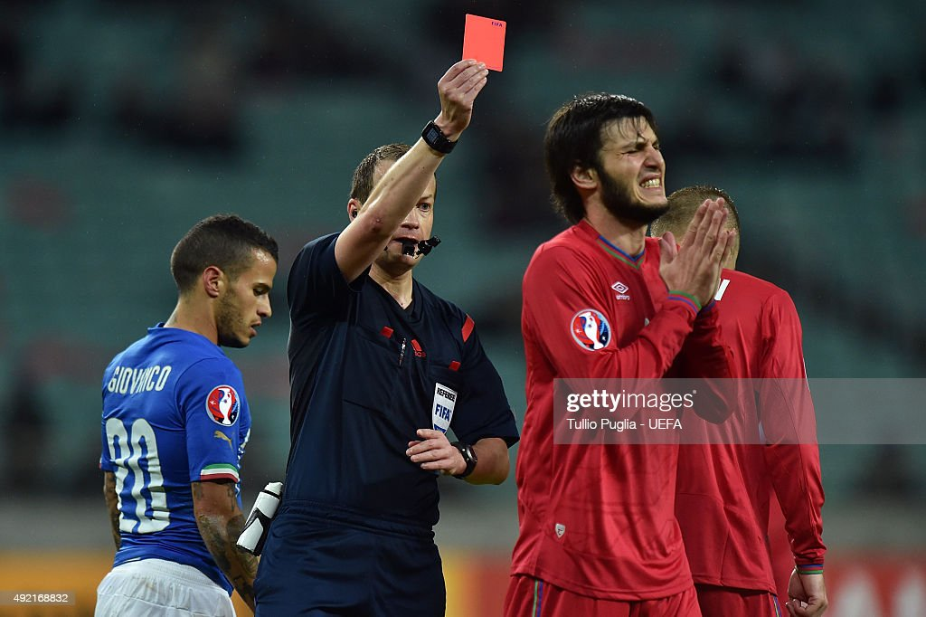 the referee William Collum gets the red card to Badavi Huseynov of Azerbaijan during the UEFA EURO 2016 Qualifier between Azerbaijan and Italy at Tofig Bahramov Stadium on October 10, 2015 in Baku, Azerbaijan.