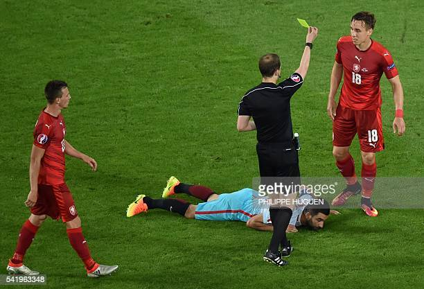 The referee William Collum shows a yellow card to Czech Republic's midfielder Josef Sural during the Euro 2016 group D football match between Czech...
