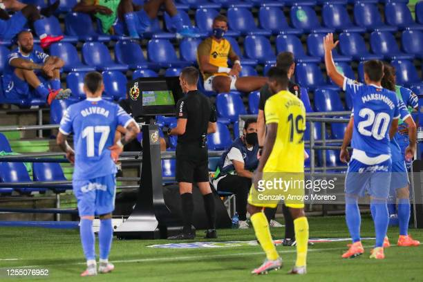 The referee Xavier Fernandez Estrada review an action on the VAR screen during the Liga match between Getafe CF and Villarreal CF at Coliseum Alfonso...