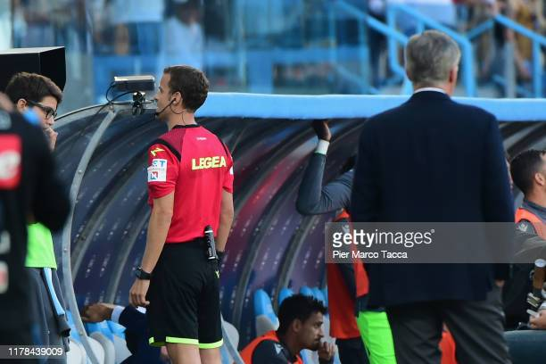The referee,Federico La Penna checks the VAR during the Serie A match between SPAL and SSC Napoli at Stadio Paolo Mazza on October 27, 2019 in...