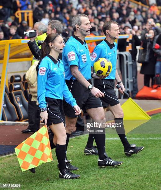 The refereeing team, including assistant referee Sian Massey and referee Martin Atkinson , ahead of the Barclays Premier League match between...