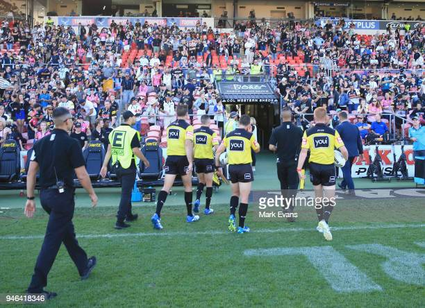The Referees are escorted off the ground after the round six NRL match between the Penrith Panthers and the Gold Coast Titans on April 15 2018 in...