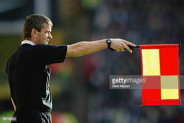 The referee's assistant flags for offside during the FA Cup Fourth Round match between Wolverhampton Wanderers and West Ham United on January 25 2004...