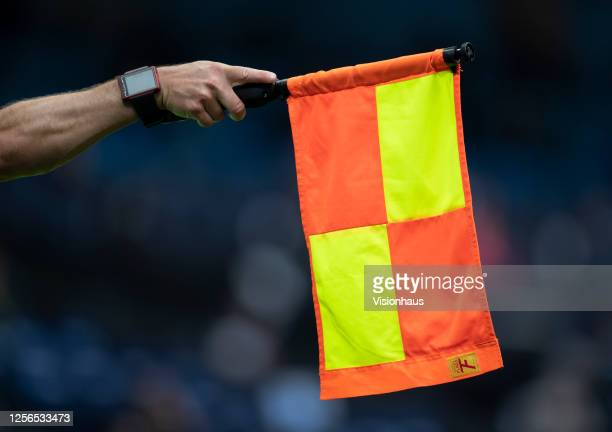 The referees assistant holds his flag out for offside during the Premier League match between Manchester City and AFC Bournemouth at Etihad Stadium...
