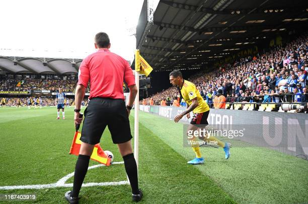 The referees assistant looks on during the Premier League match between Watford FC and Brighton Hove Albion at Vicarage Road on August 10 2019 in...