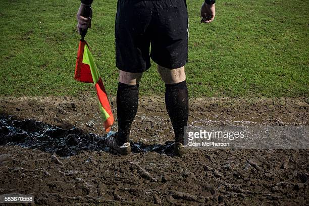 The referee's assistant standing in the mud during the second-half of Belper Town's match against Gresley, in a Northern Premier League, first...