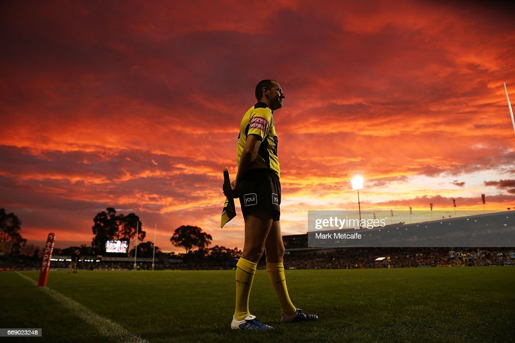 The referee's assistant watches the big screen during the round seven NRL match between the Penrith Panthers and the Cronulla Sharks at Pepper Stadium on April 16, 2017 in Sydney, Australia.