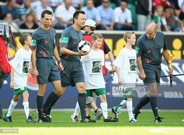 The referees Dirk Margenberg Marc Seemann and Christian Bandurski are seen prior the Bundesliga match between VfL Wolfsburg and Eintracht Frankfurt...