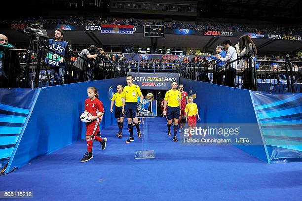 The referees enter the pitch during the Serbia v Slovenia match during the UEFA Futsal EURO 2016 match between Serbia and Slovenia at Arena Belgrade...