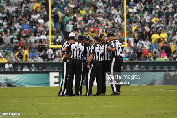 The referees huddle during the game between the Indianapolis Colts and the Philadelphia Eagles on September 13 at Lincoln Financial Field in...