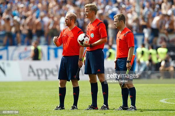The Referees Julian Henning Eichhorst Arne Aarnink and Lars Thiemann during the Third League match between Preussen Muenster and Hansa Rostock at...