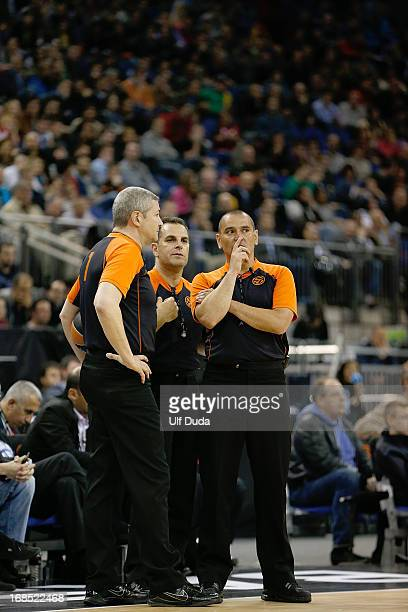 The referees Luigi Lamonica Elias Koromilas Ilija Belosevic in action during the Semifinal B game between FC Barcelona Regal v Real Madrid at O2...
