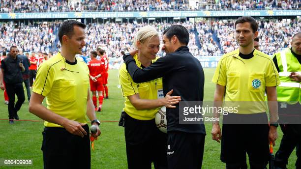 The Referees Markus Buesing Bibiana Steinhaus Coach Ilia Gruev of Duisburg and Referee Marcel Unger after the third league match between MSV Duisburg...
