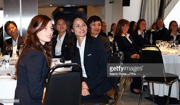 The referees of the FIFA U20 Women's World Cup are pictured during the referees dinner at Tour olympique de Montreal on August 2 2014 in Montreal...