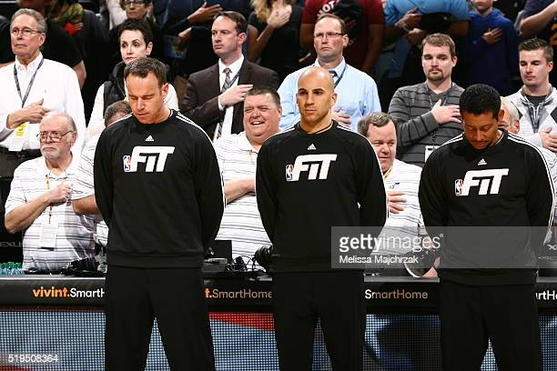 The referees stand for a moment of silence for the National Anthem before the Utah Jazz against the Detroit Pistons at vivintSmartHome Arena on...
