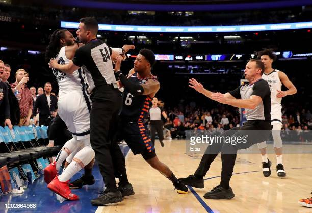 The referees try to break up a fight between Jae Crowder of the Memphis Grizzlies and Elfrid Payton of the New York Knicks in the final minute of the...