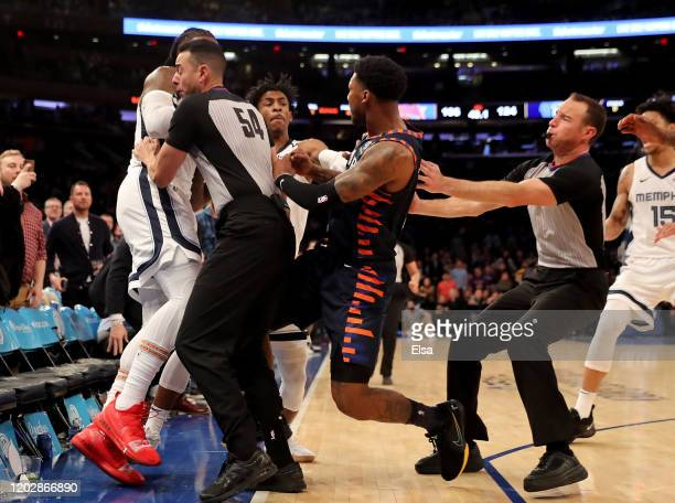 The referees try to break up a fight between Jae Crowder of the Memphis Grizzlies and Elfrid Payton of the New York Knicks as the benches clear in...