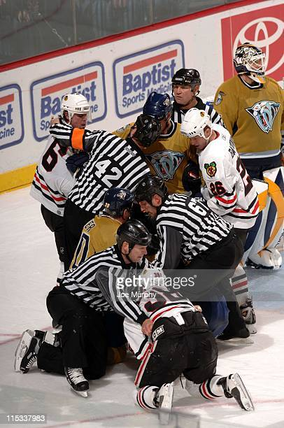 The referees try to stop a fight between the Predators and the Blackhawks during the third period. The Nashville Predators beat the Chicago...