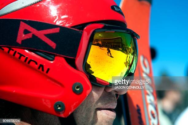 The reflection of a rider and skier are seen in Mike Tinkle's googles during the 70th annual Leadville Ski Joring weekend competition on March 3 2018...