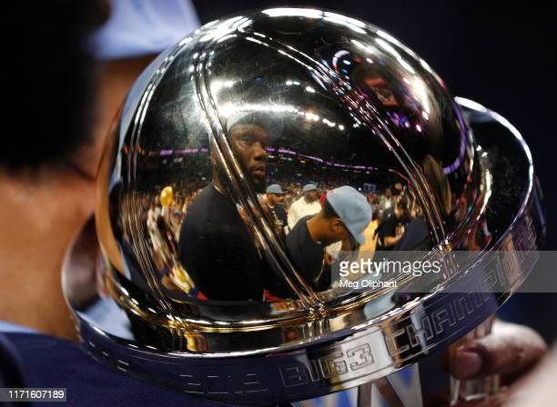 The reflection of Al Jefferson of the Triplets is seen in the championship trophy after the Triplets defeated the Killer 3s to win the BIG3...