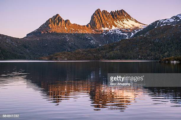 The reflection of Cradle mountain at dawn.