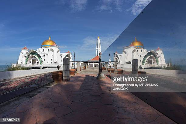 The reflection of Masjid Selat, Melaka, Malaysia
