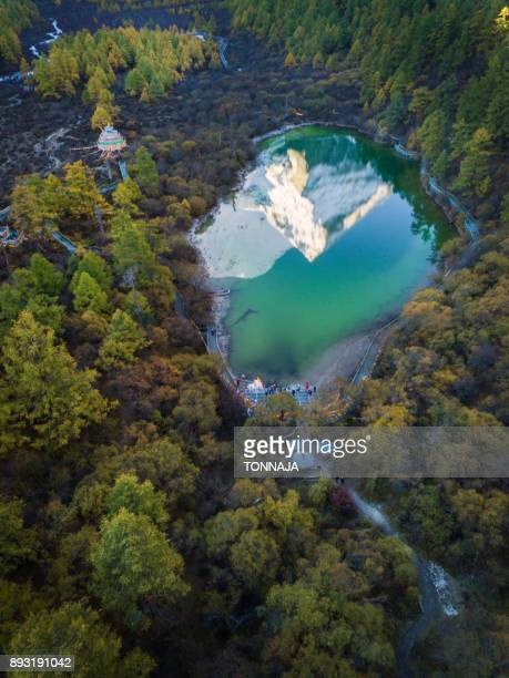 the reflection of snowy mountain on zhuomala lake in yading nature reserve, sichuan, china - nature reserve stock pictures, royalty-free photos & images