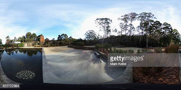 The reflection pool and the shell of the Broad Arrow cafe are seen in the Memorial Garden of the Port Arthur Historical Site on April 18, 2016 in...