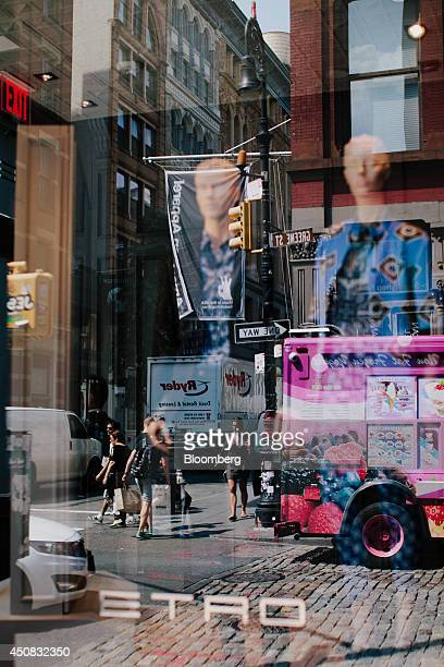 The reflections of shoppers and pedestrians are seen in the window of a shop in the SoHo neighborhood of New York US on Wednesday June 18 2014 The...