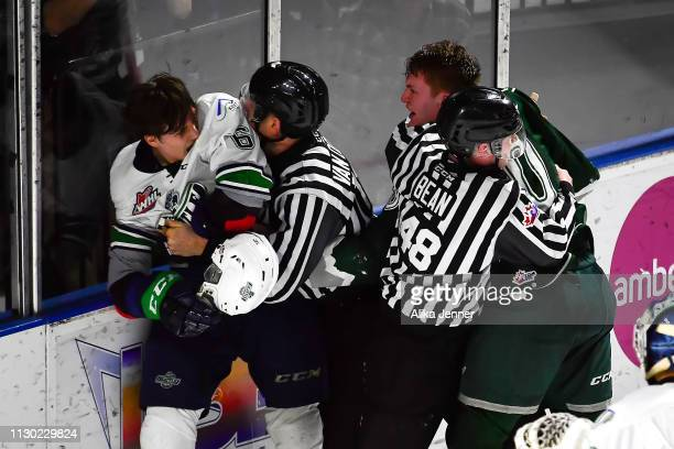 The refs break up a fight between Tyrel Bauer of the Seattle Thunderbirds and Robbie Holmes of the Everett Silvertips at accesso ShoWare Center on...