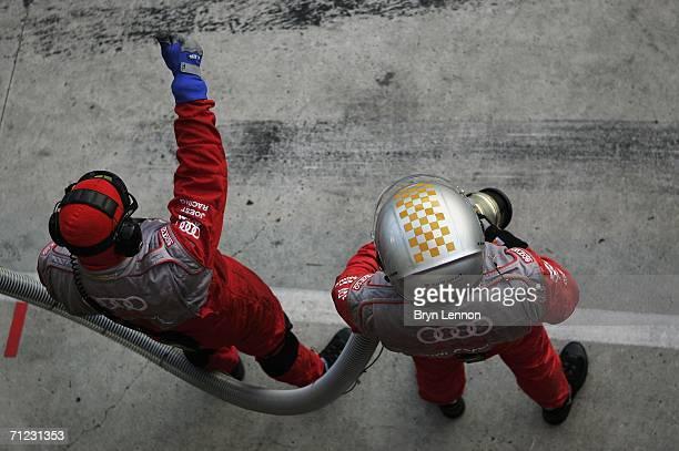 The refuelling mechanics await Frank Biela's pit stop during the Le Mans 24h race on June 18 2006 at the Circuit des '24 Heures du Mans' in Le Mans...